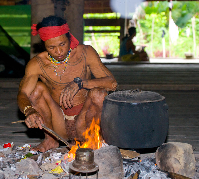 Free Man Mentawai Tribe Sitting By The Fire In The House. Royalty Free Stock Image - 81022106