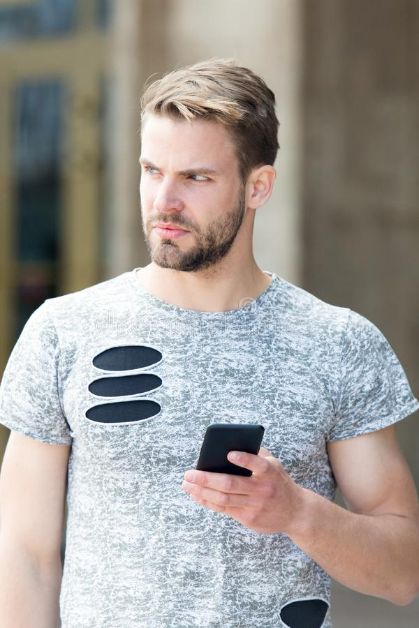 Man messaging online smartphone. Modern smartphone application. Easy communication. Send email. Responding message royalty free stock photos