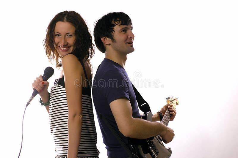man met een gitaar en vrouw royalty-vrije stock fotografie
