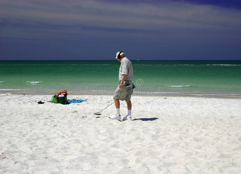 Man with metal detector royalty free stock photography