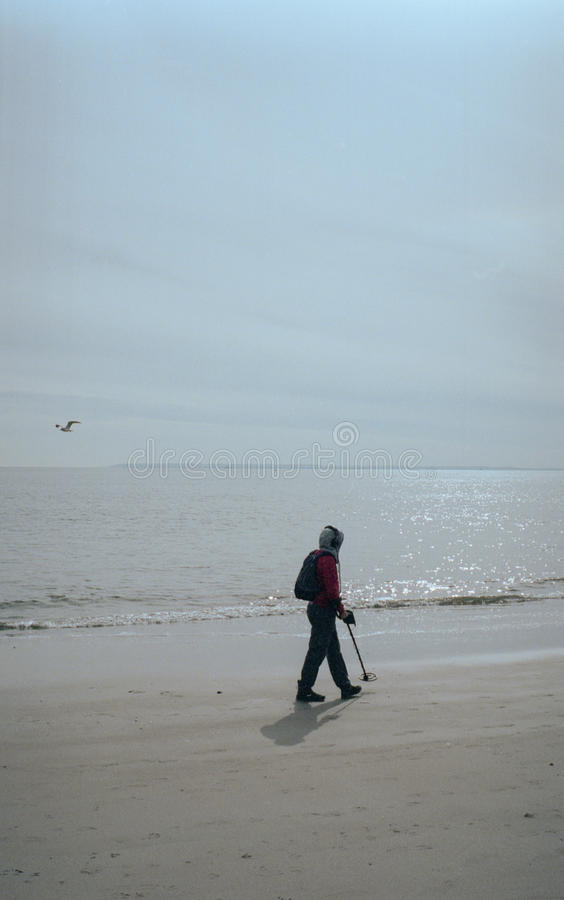 Man with a metal detector royalty free stock photography