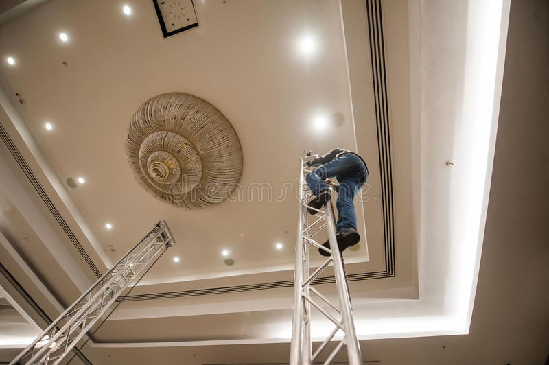 Man on a metal stairway sets light royalty free stock photo