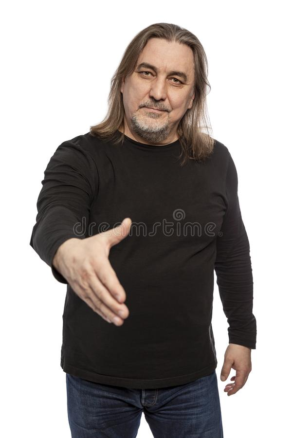 A man with middle-aged long hair stretches out his hand for a greeting. Isolated on a white background. stock photos
