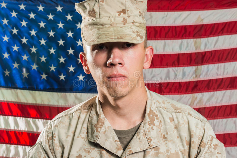 Man in military uniform on USA flag background royalty free stock image