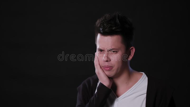 A Man Mimicing Against a Black Background royalty free stock image