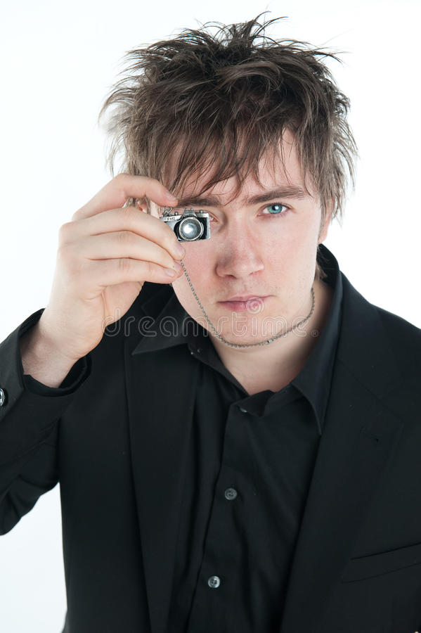 Man with miniature camera stock photos