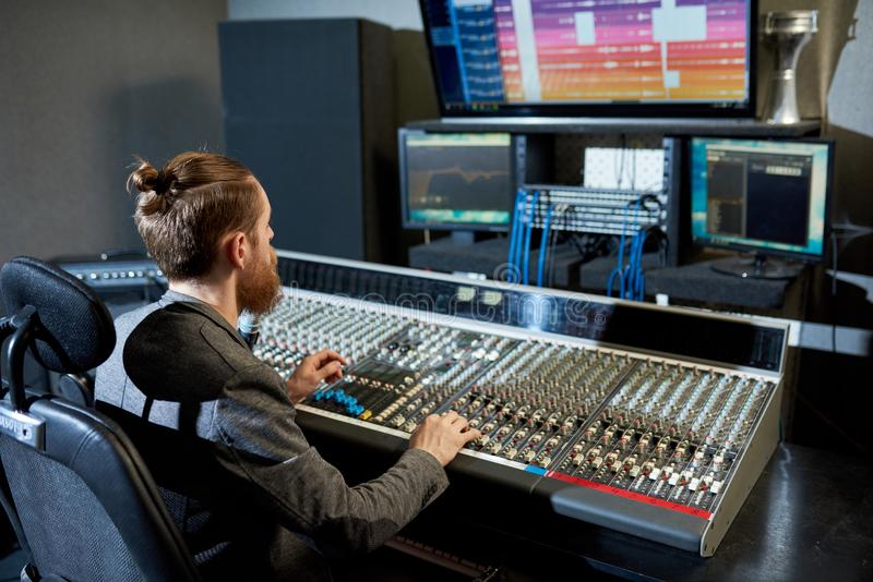 Man mixing and creating music stock photography