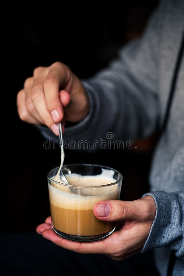 Man mixing a cup of coffe stock photography