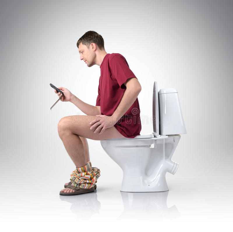 Man With Mobile Phone Sitting On The Toilet Stock Image ...
