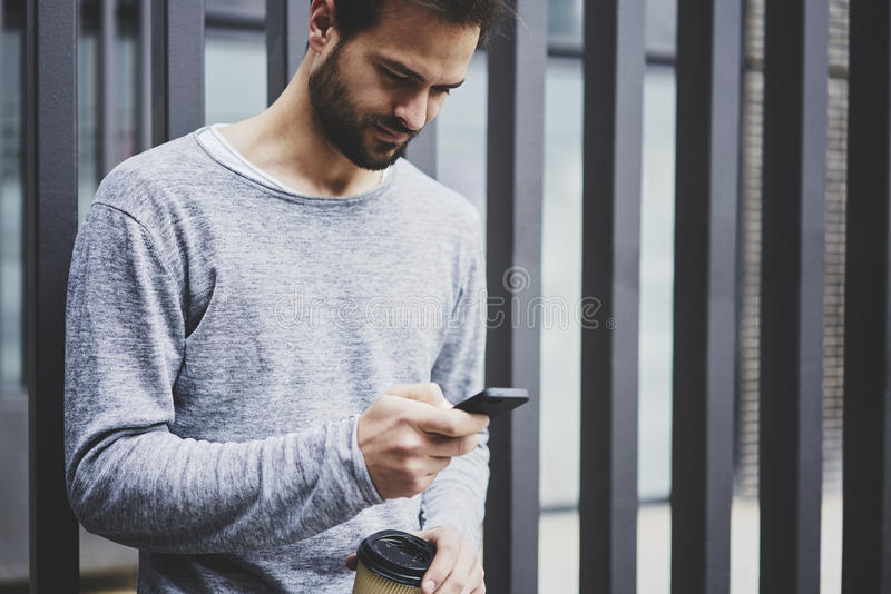 Man with mobile phone smartphone and fast 4G internet in roaming strolling outdoors stock images