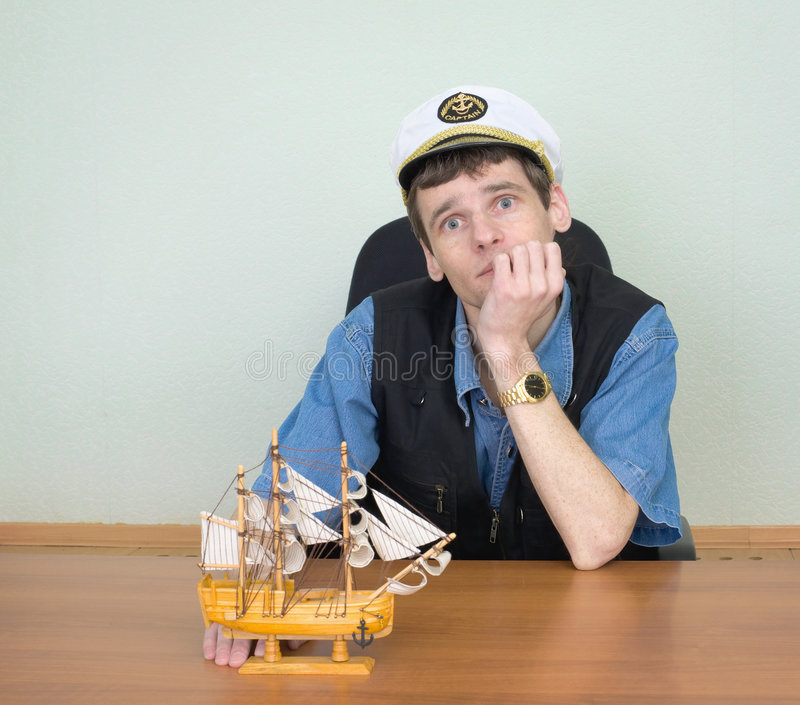 Man with model of a sailing vessel royalty free stock photography