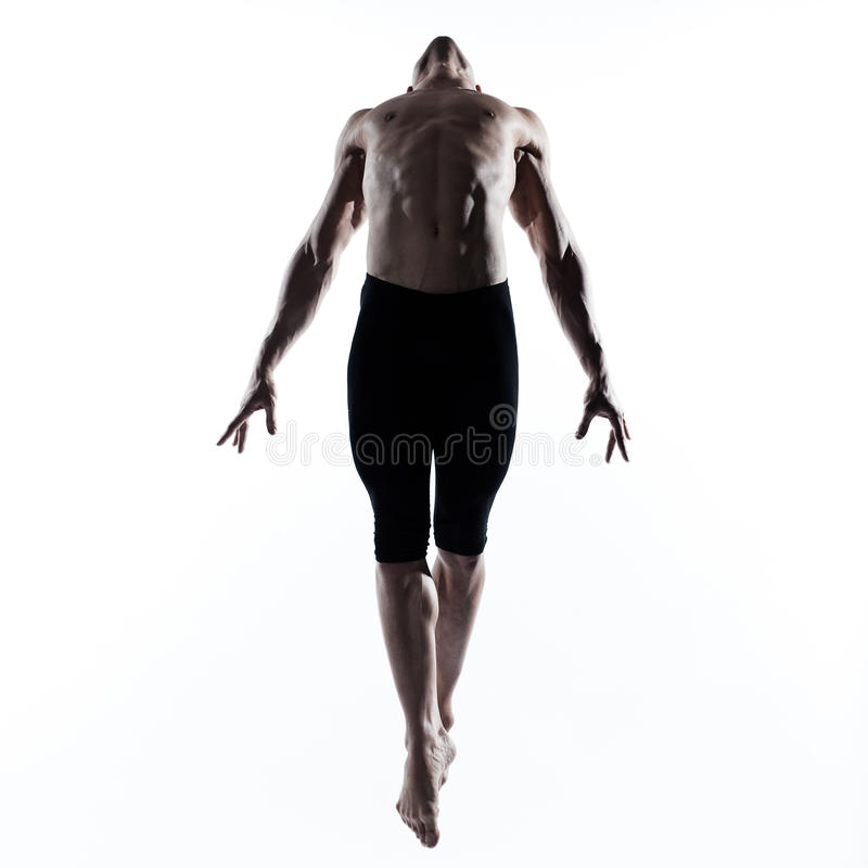 Man modern ballet dancer dancing gymnastic acrobatic jumping royalty free stock images