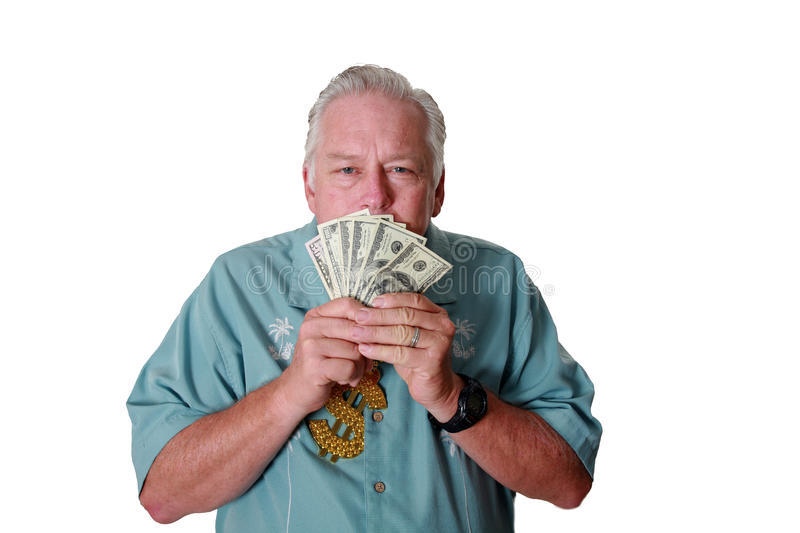 A man with money. A man wins money. A man has Money. A man Sniffs Money. A man Loves Money. A man and his money. A man is Rich. A royalty free stock photography