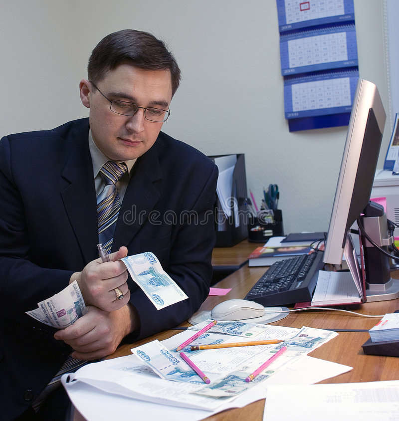 Man and money. Office thoughts royalty free stock photos