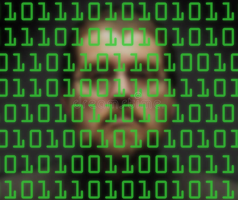 Man monitoring binary code. Man's out-of-focus face behind green binary code royalty free stock photos