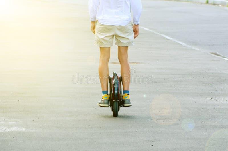 A man on a mono-wheel royalty free stock image