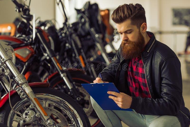 Man with motorbike royalty free stock photos
