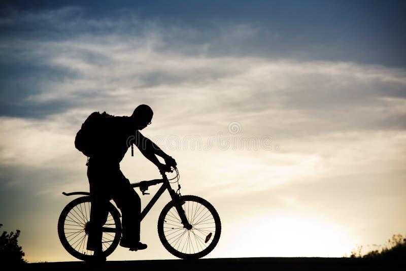 Man at mountain bicycle royalty free stock photo