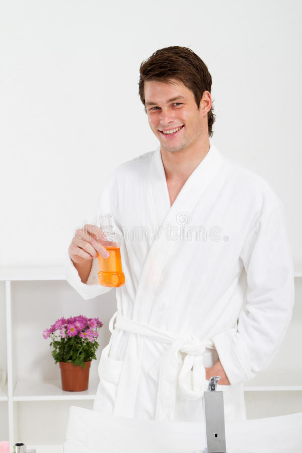 Man mouth wash stock photography