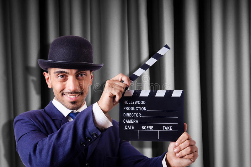 Download Man with movie clapper stock image. Image of board, drapes - 32218763