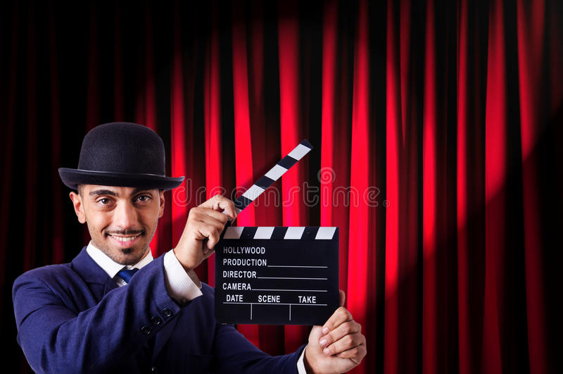 Download Man With Movie Clapper Royalty Free Stock Photos - Image: 33225358