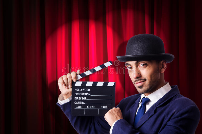 Download Man with movie clapper stock photo. Image of chalkboard - 33349446