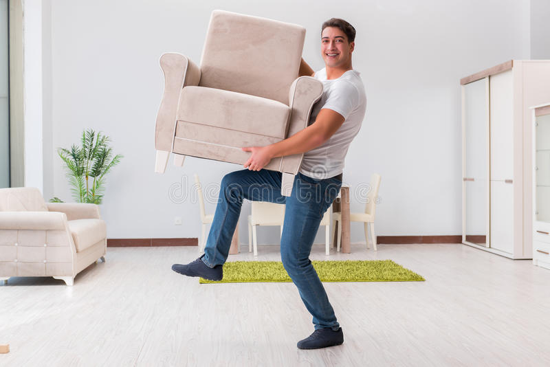 Download The Man Moving Furniture At Home Stock Photo   Image Of Apartment,  Living: