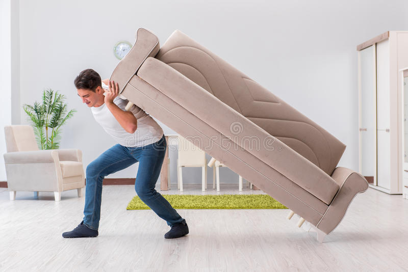 Download The Man Moving Furniture At Home Stock Image   Image Of Holding,  Heavy: