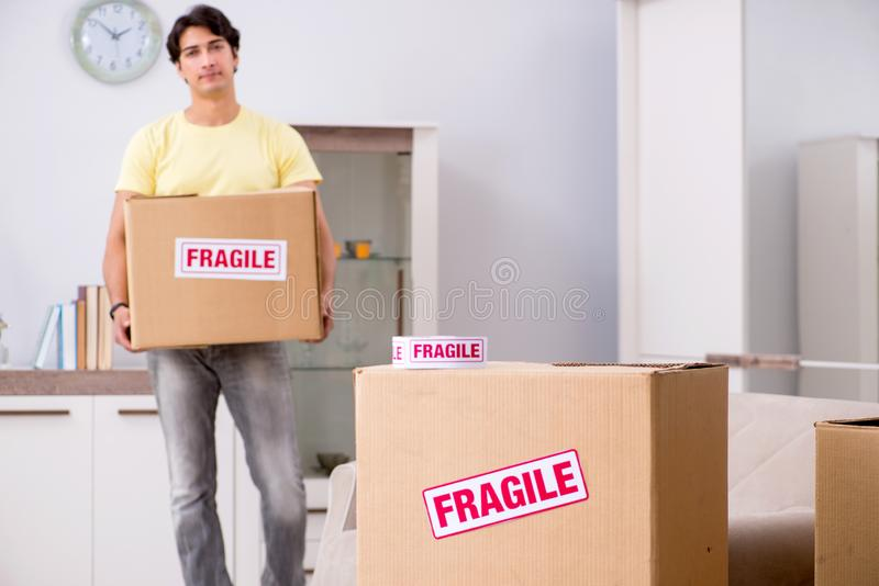 The man moving house and relocating with fragile items royalty free stock photos