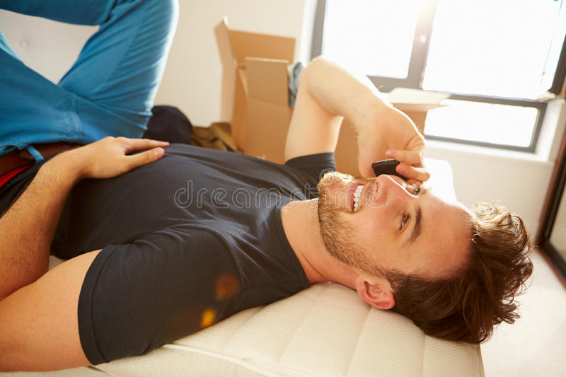 Download Man Moving Into New Home Talking On Mobile Phone Stock Photo - Image: 34164050
