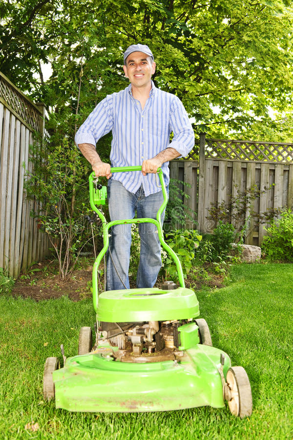 Download Man mowing lawn stock photo. Image of green, outdoors - 14813932