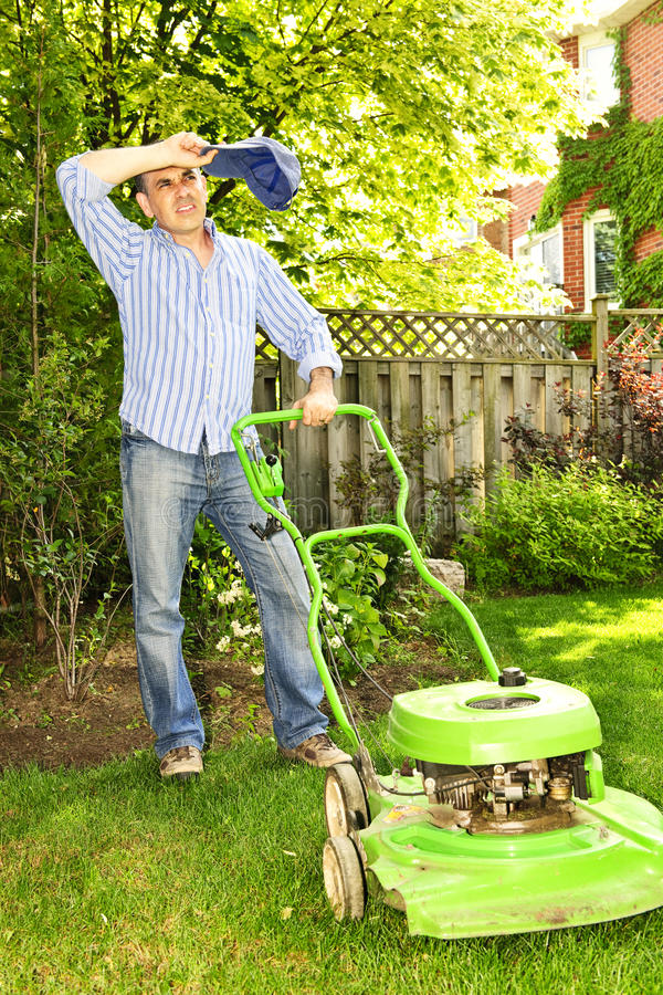 Download Man mowing lawn stock image. Image of garden, lawnmower - 14999239