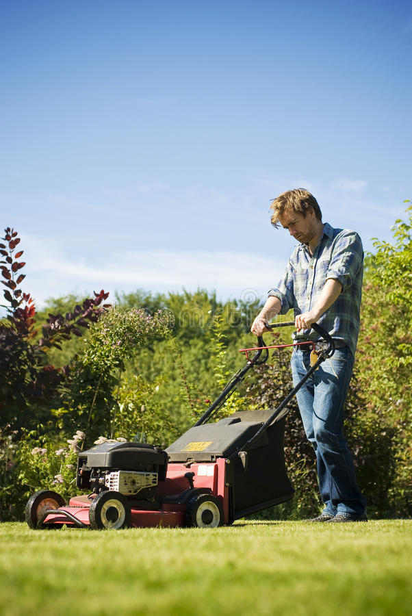 Man mowing lawn royalty free stock photo