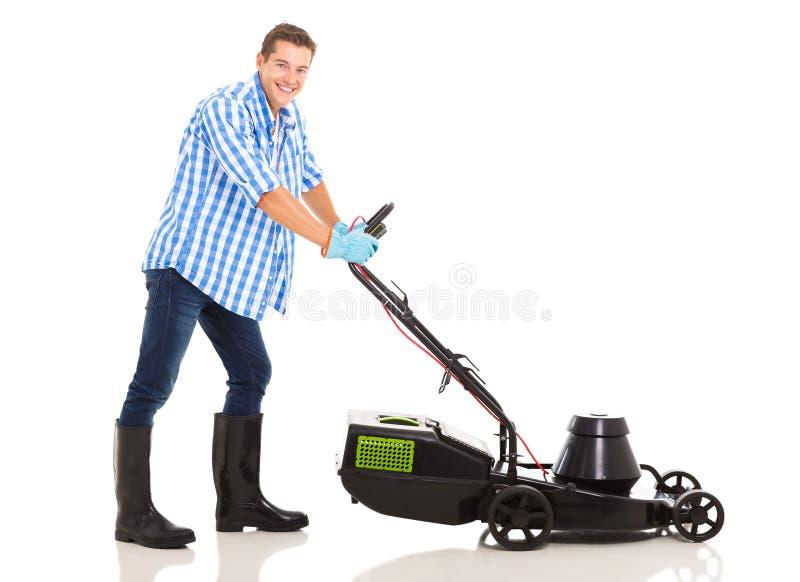 Man mowing lawn stock image