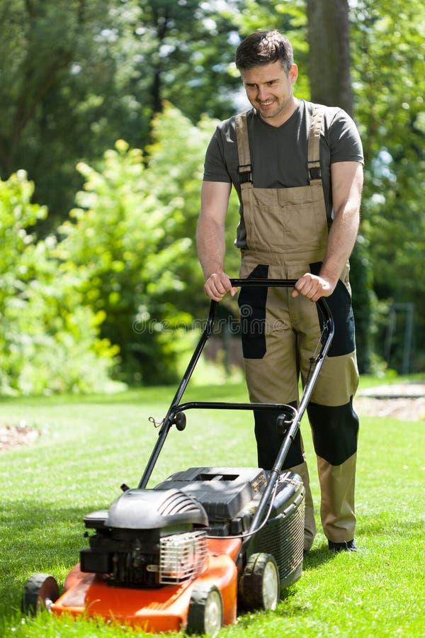 Man mowing lawn royalty free stock photos
