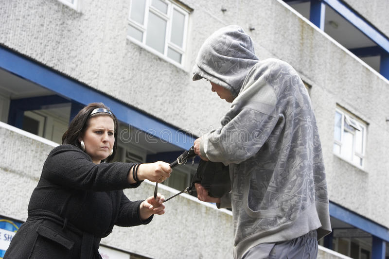 Man Mugging Woman In Street stock photography