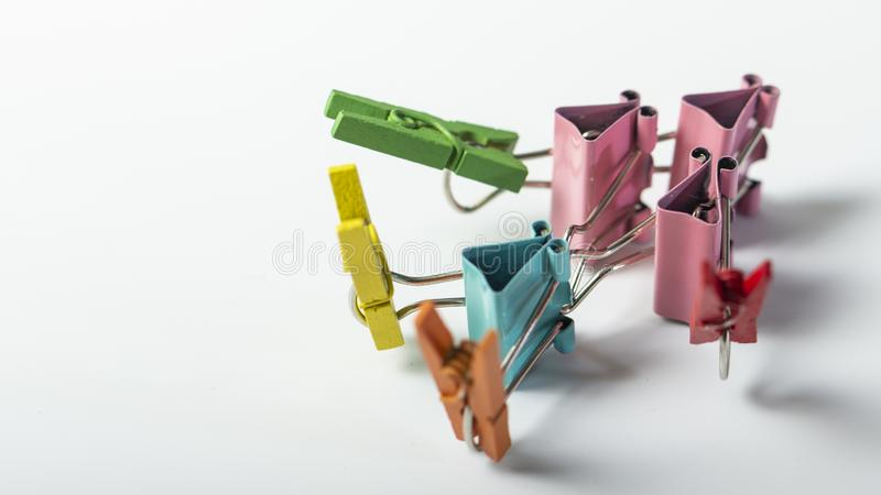 Man, from multi-colored office clips for paper on white background royalty free stock photography