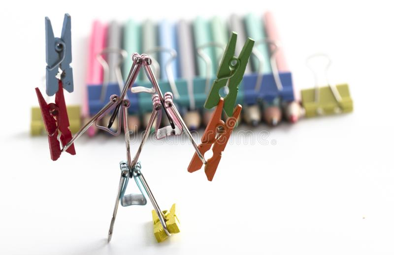 Man, from multi-colored office clips for paper on white background selective focus royalty free stock images