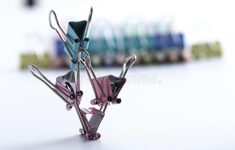 Man, from multi-colored office clips for paper on white background selective focus stock photo