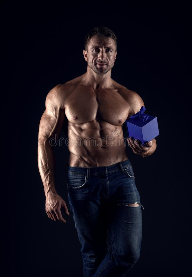 Man with muscular bare torso. best present. Temptation. brutal male hold gift box. muscular and confident macho man stock photos