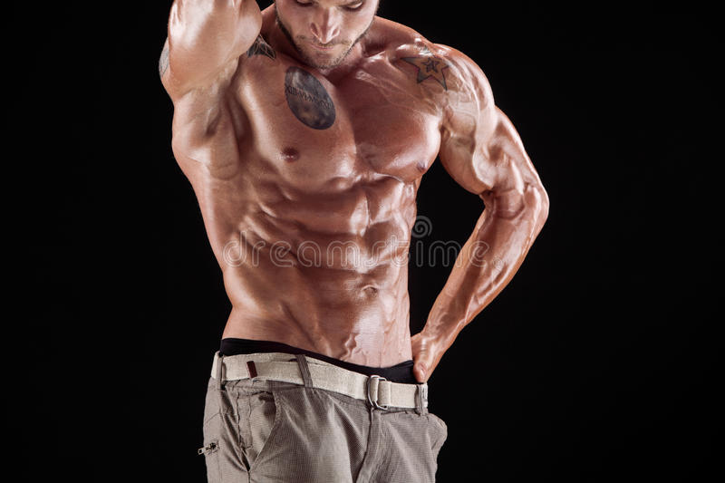 Man with muscular torso royalty free stock photography