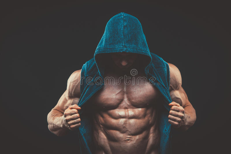 Man with muscular torso. Strong Athletic Men Fitness Model stock image