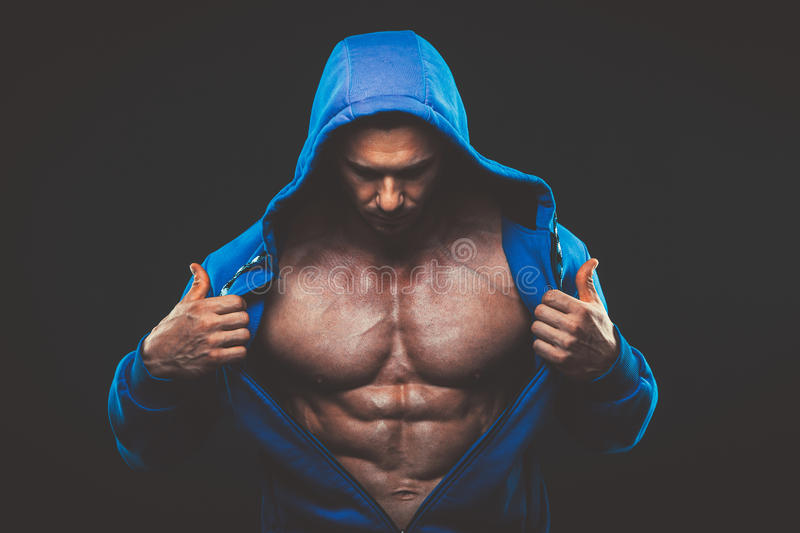 Man with muscular torso. Strong Athletic Men Fitness Model royalty free stock photos