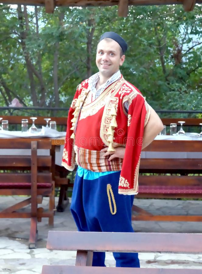 A man in national Montenegro costume. At the nice folk style evening meal in Montenegro royalty free stock image
