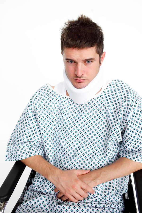 Man with a neck brace in hospital stock photos