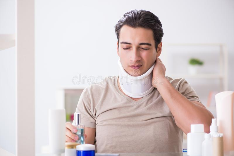 The man with neck brace after whiplash injury. Man with neck brace after whiplash injury royalty free stock photo