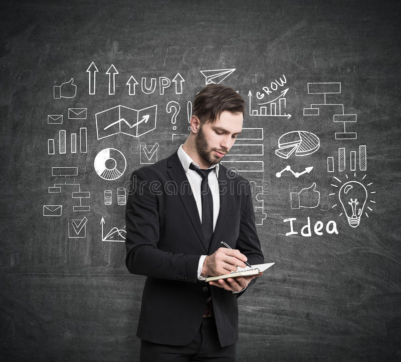 Download Man With Notebook And Business Plan Sketch Stock Photo - Image: 83722386