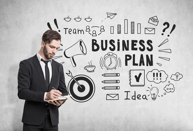 Download Man With Notebook And Business Plan Sketch Stock Photo - Image: 83722249