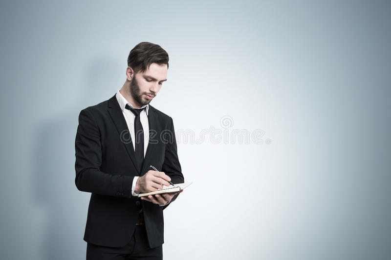Download Man With Notebook Near A Blue Wall Stock Photo - Image: 83722711