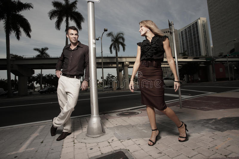 Man noticing a woman. Passing by on the street royalty free stock photography